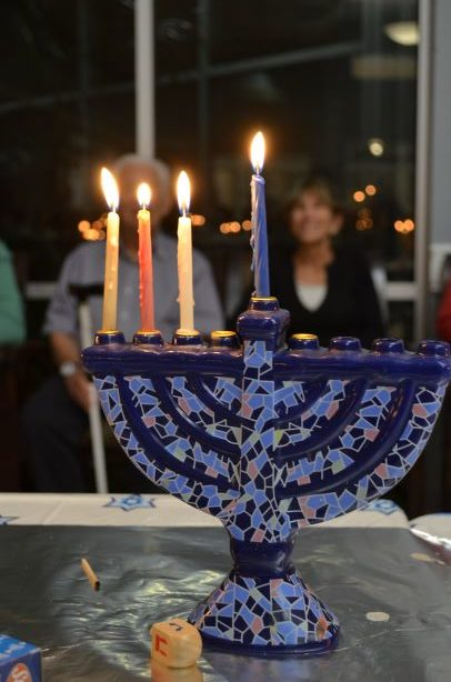 lit menorah for chanukah at aviva senior living