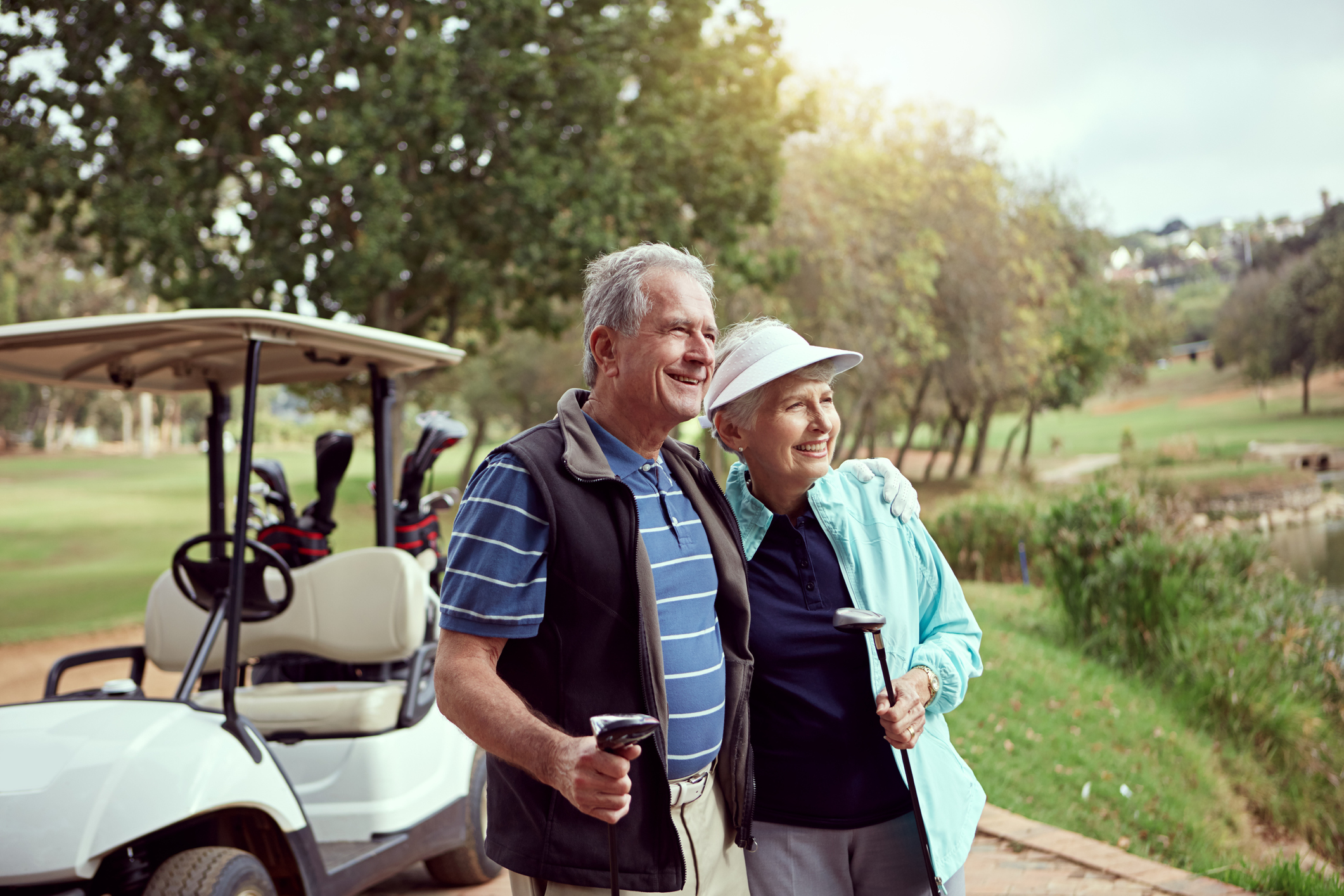 senior couple enjoying the golf course at the meadows country club