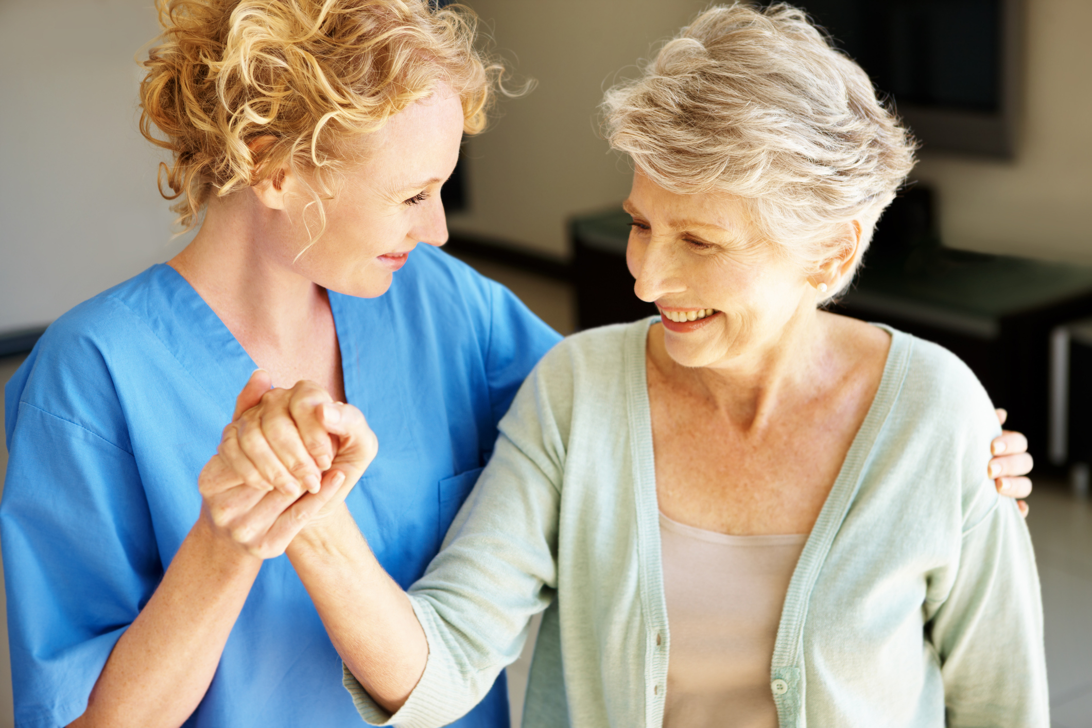 skilled nursing facility nurse caring for senior patient