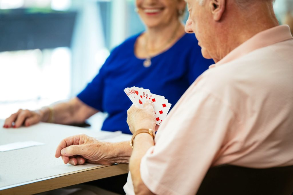 Assisted living residents playing cards.
