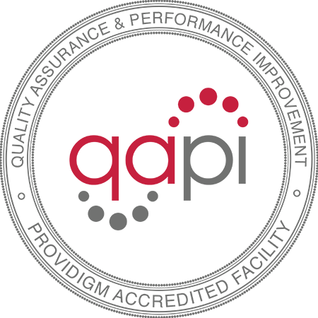 A grey and red image of the quality assurance & performance improvement logo